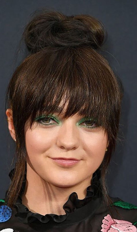 Top-Bun-With-Two-Tiered-Bangs Layered Hairstyles With Bangs