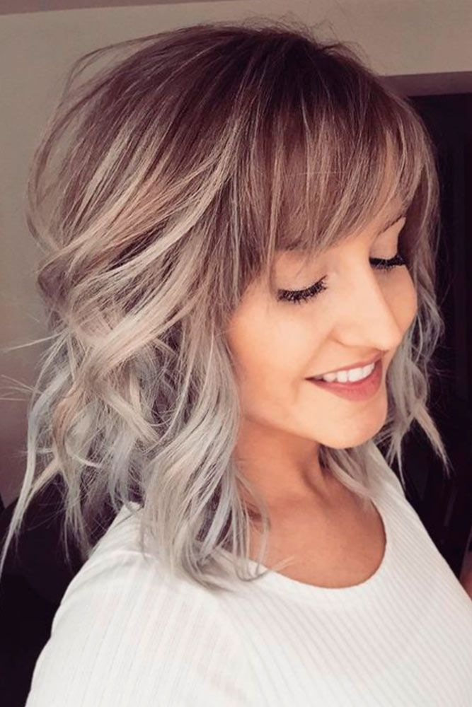 Wavy-Layered-Hair-with-Side-Bangs Modern Hairstyles for Women to Look Trendy