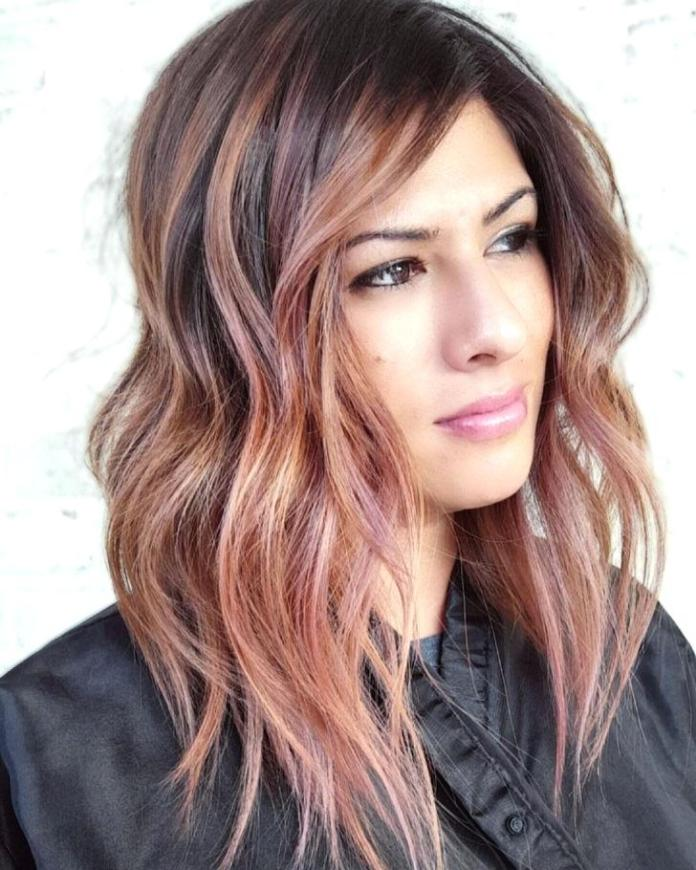 Neat-Twisted-hairstyle-with-a-color-stint Most Attractive Fall Hairstyles to Try This Year