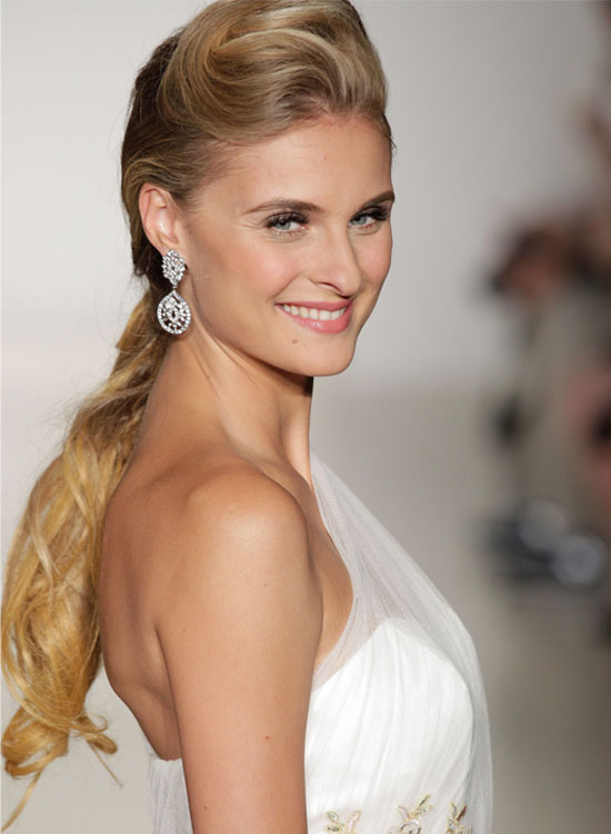 Textured-Low-Pony-With-Twisted-Pouf Bridal Hairstyle Ideas For Your Reception