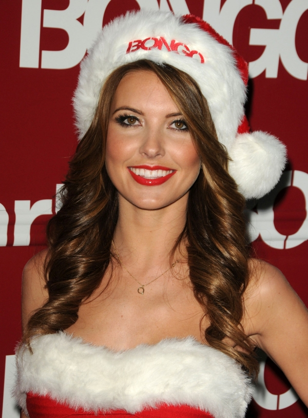 The-Feather-Look-Layered-Cut-Hair-with-Perfect-Curls Christmas Party Hairstyles to Enhance Your Look