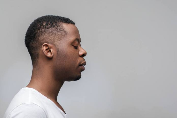 Low-Faded-Curly-Hair Cool and Charming Natural Hairstyles for Men