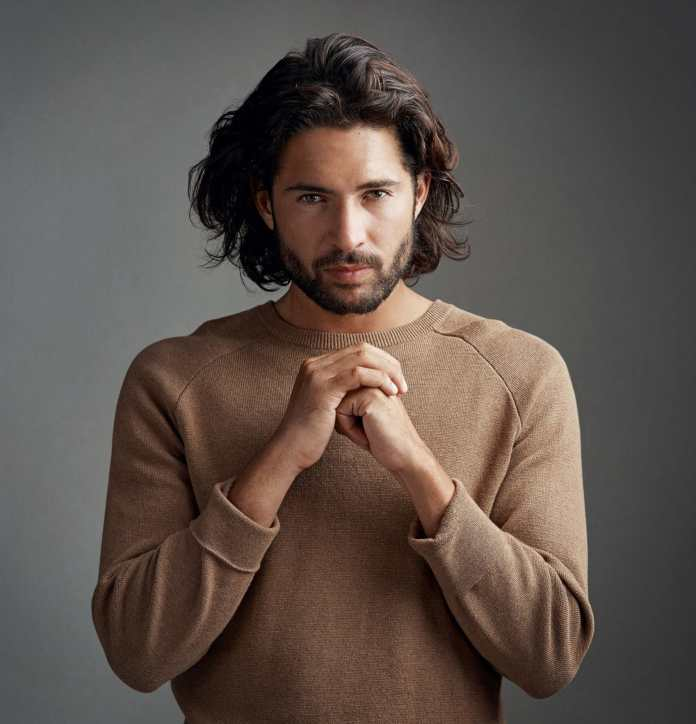 Messy-Wavy-Hairstyle Cool and Charming Natural Hairstyles for Men