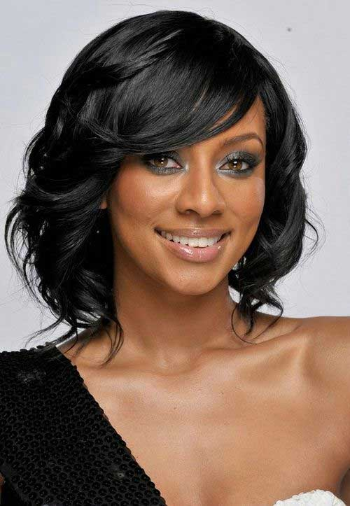 Wavy-Layered-Short-Bob-with-Bangs-for-Black-Ladies New Short Hairstyles With Bangs For Black Women