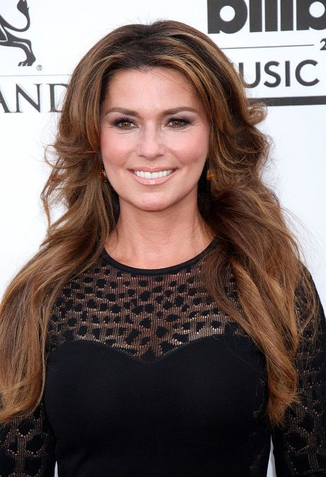 Center-Parted-Long-Wavy-Hairstyle Wavy Hairstyles for Women Over 50 – Look Young And Beautiful