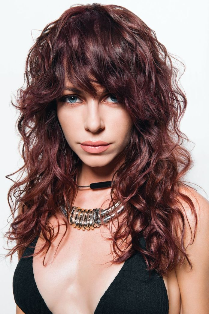 Curly-Shaggy-Hair-with-Side-Bangs Modern Shag Haircut for Utter Stylish Look