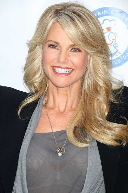 Golden-Blonde-Long-Wavy-Hair-with-Side-Bangs Long Hairstyles for Women Over 50 – Look Trendy And Fashionable