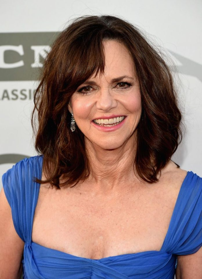 Layered-Hair-with-Side-Swept-Bangs Medium Hairstyles for Women Over 50