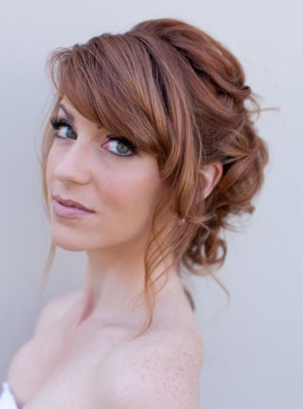Little-Messy-Puffed-Brunette-Bun-with-Side-Bangs Most Beautiful Wedding Hairstyles with Bangs