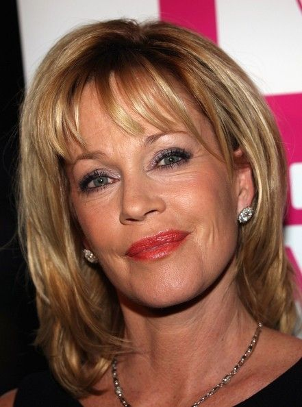 Medium-Blonde-Hair-with-Bangs-and-Layers Medium Hairstyles for Women Over 50