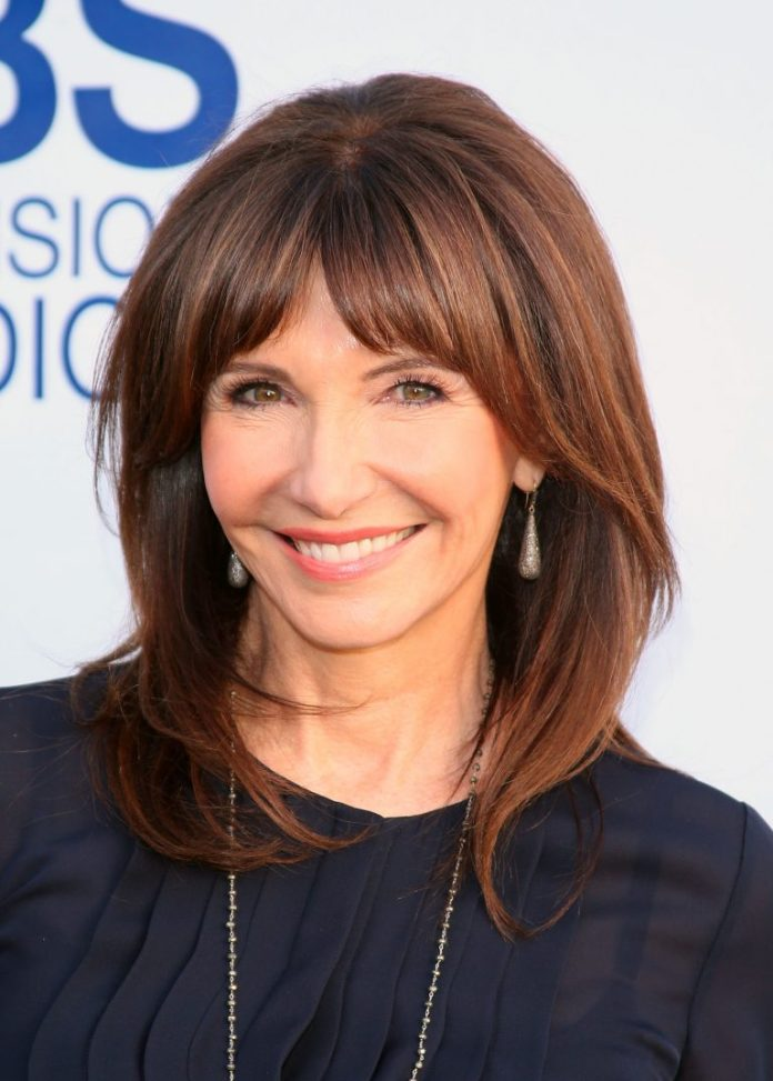 Medium-Brown-Highlights-with-Long-Fringes Hairstyles For Women Over 50 With Bangs