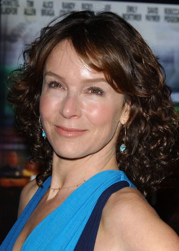 Medium-Curly-Hairstyle-with-Bangs Curly Hairstyles for Women Over 50