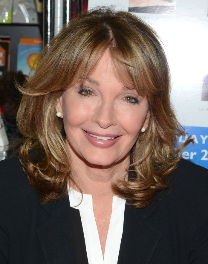 Medium-Layered-Hair-with-Curls-and-Parted-Bangs Medium Hairstyles for Women Over 50