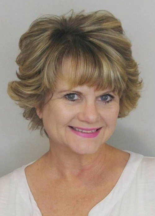 Short-Blonde-Curly-Hairstyle-with-Bangs Curly Hairstyles for Women Over 50