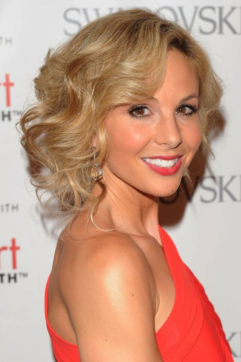 Side-Swept-Blonde-Retro-Curls Curly Hairstyles for Women Over 50