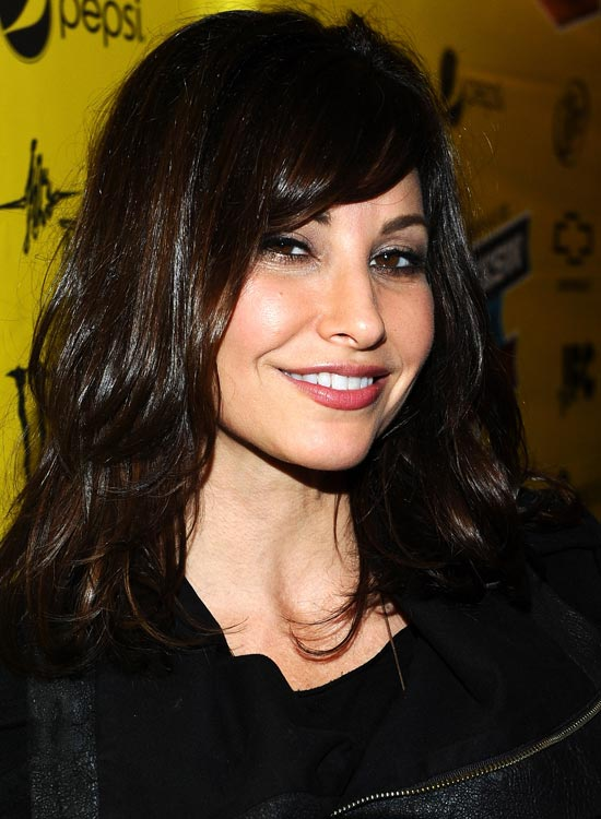 Tousled-Medium-Layered-Bob-with-Bangs Medium Hairstyles for Women Over 50