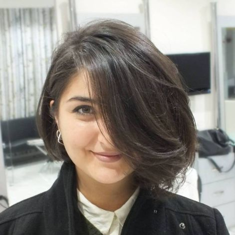 Dramatic-Sideswept-Bob 20 Stylish and Chic Bobs for Round Faces