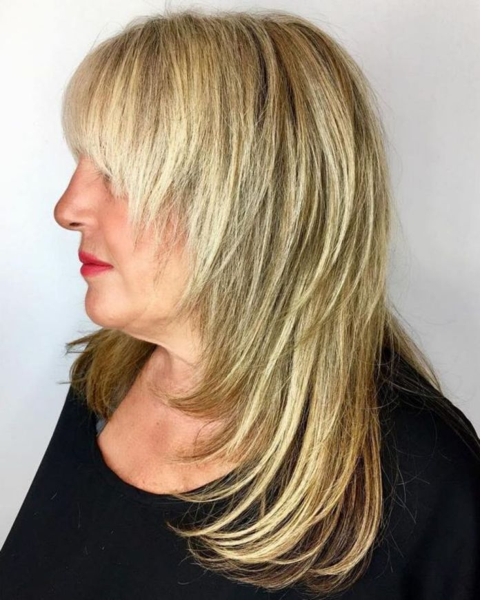 Long-Cascading-Haircut-with-Full-Bangs Shaggy Hairstyles for Women with Fine Hair over 50