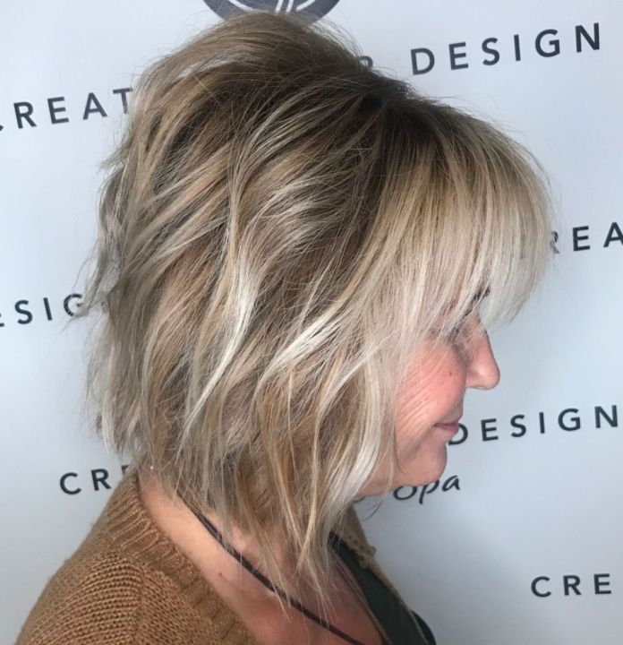 Shaggy-Angled-Blonde-Balayage-Bob Shaggy Hairstyles for Women with Fine Hair over 50