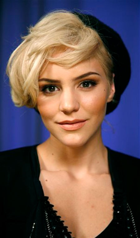Side-Swept-Blonde-Hairstyle-with-a-Cap Cute Short Hairstyles