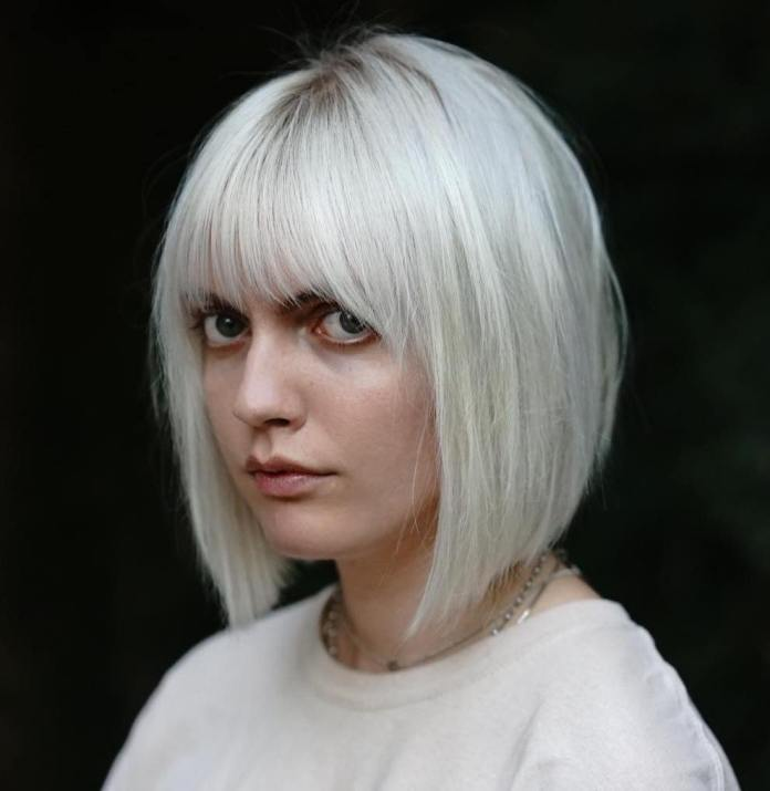 Sleek-Platinum-Bob 20 Stylish and Chic Bobs for Round Faces
