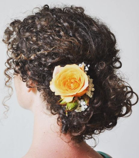 Spiral-Curl-Updo-with-Flower-Adornment Quick and Easy stunning Updos for Curly Hair