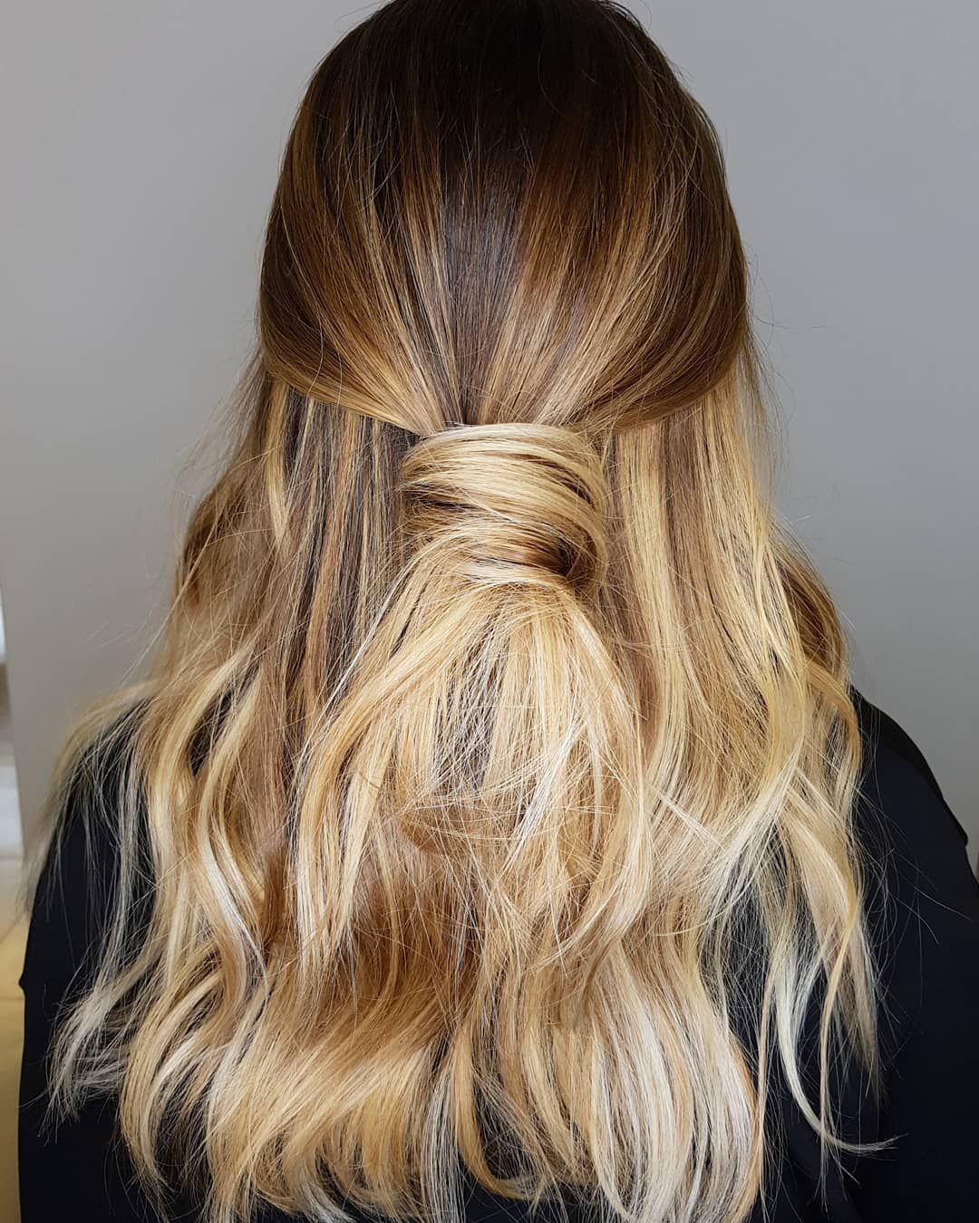 Straight-Hair-with-a-Knot Trendy and Stunning Long Hairstyles 2020