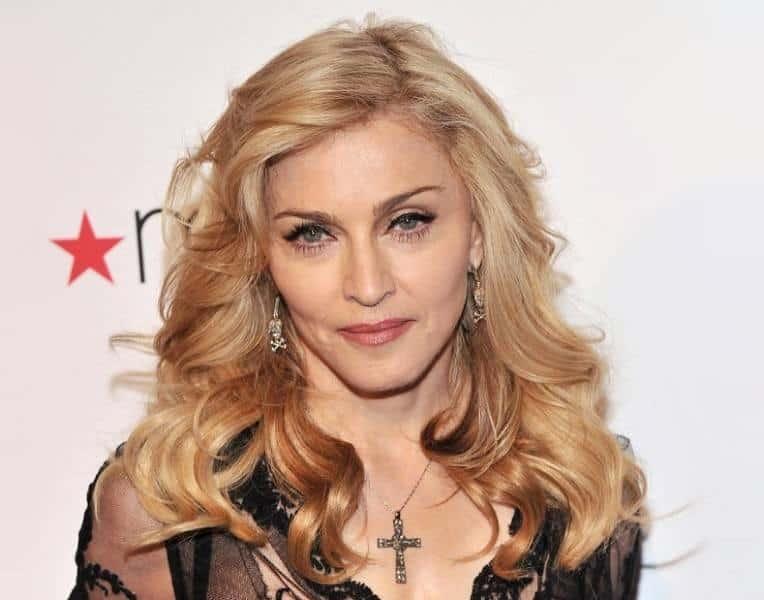 Blonde-Hair-with-Brown-Underneath Loveliest Medium Length Hairstyles for Older Women