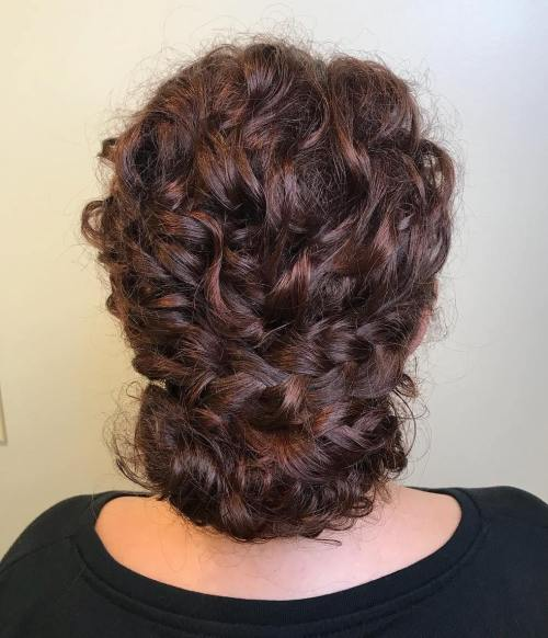 Chignon-with-Curly-French-Braids 10 Super-Flattering Braided Hairstyles for Curly Hair of Different Types