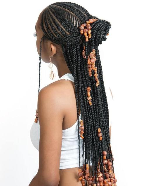 Cornrows-with-Artistic-Beaded-Twisted-Bun 14 Amazing Fulani Braids for Black Women