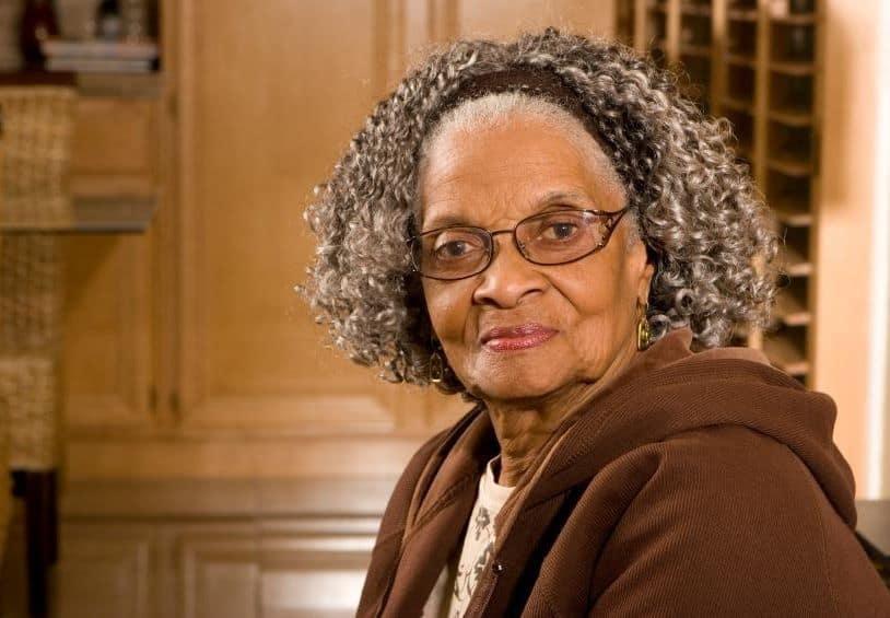 Curly-Hair-with-Headband Loveliest Medium Length Hairstyles for Older Women