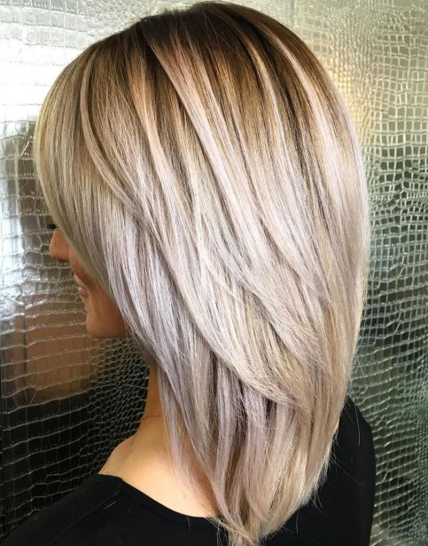 Elongated-Layered-Cut-with-Voluminous-Crown Gorgeous haircuts for thick hair of medium length in 2020