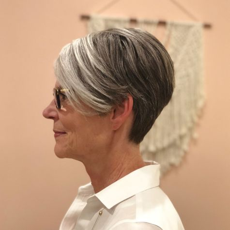 Gray-Pixie-with-Longer-Highlighted-Bangs 10 Flattering and Stylish Hairstyles for Women over 50 with Glasses