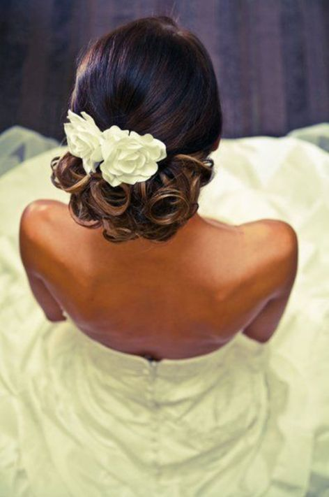 Low-Updo-With-Flowers-And-Lovely-Ringlets 14 Flattering Black Wedding Hairstyles