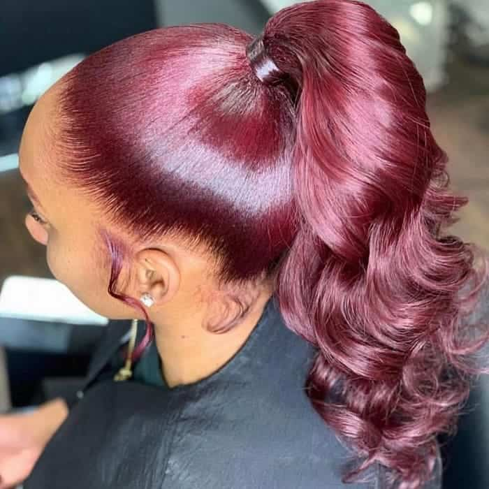 Shiny-and-Wavy Stunning Ponytail Hairstyles for Black Women