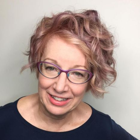 Short-Curly-Hair-with-Colorful-Eyewear 10 Flattering and Stylish Hairstyles for Women over 50 with Glasses