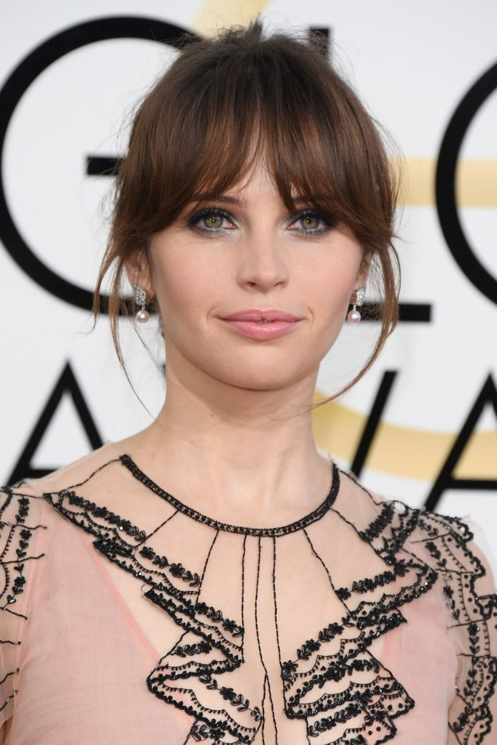 Updo-With-Smooth-Bangs 14 Best Hairstyles With Bangs to Inspire Your Next Cut