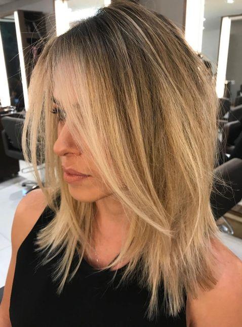 Medium-Choppy-Cut-with-Long-Bangs 14 Mind-Blowing Haircuts for Thin Hair