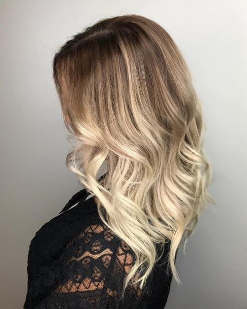 long_layers_with_a_loose_wave 12 Trending Long Layered Haircuts in 2020