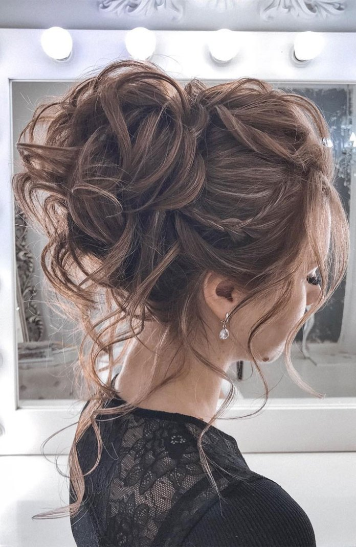 Braided-Streaks-with-Curly-Messy-Bun Messy Bun Hairstyle is the New Style to Enhance Your Look