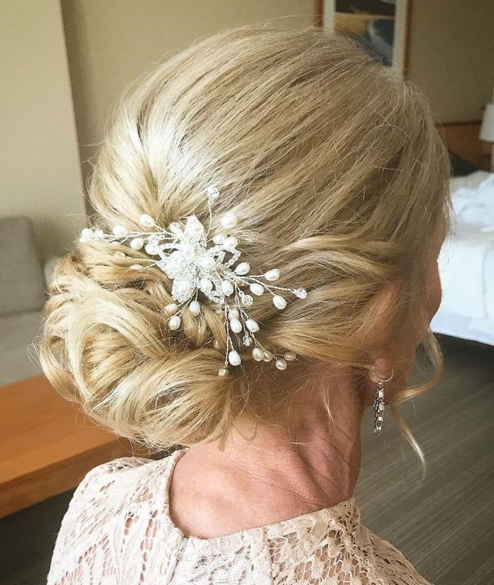 Low-Curly-Bun 15 Beautiful Hairstyles for Mother of The Bride That's Easy To Put Together