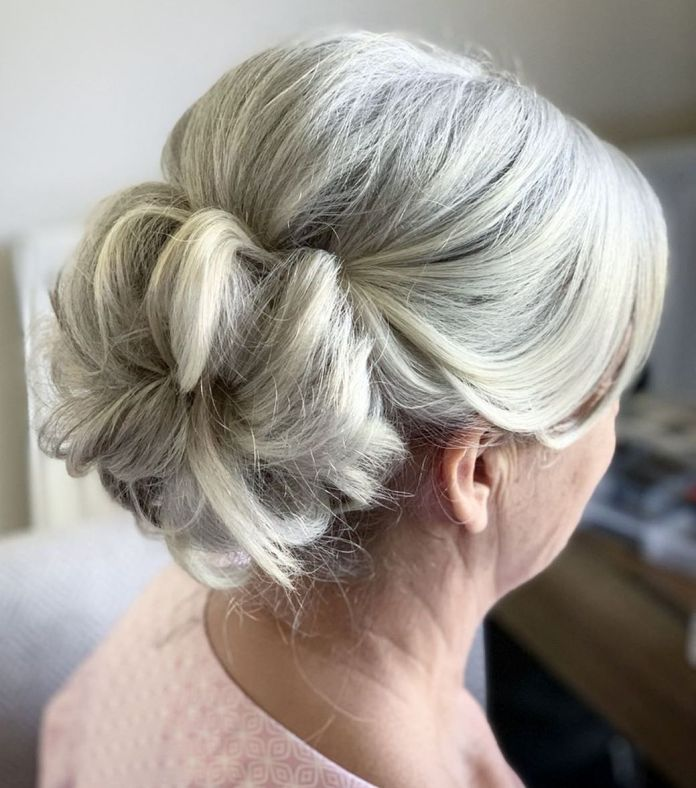 Messy-Donut-Bun-with-a-Bouffant 15 Beautiful Hairstyles for Mother of The Bride That's Easy To Put Together