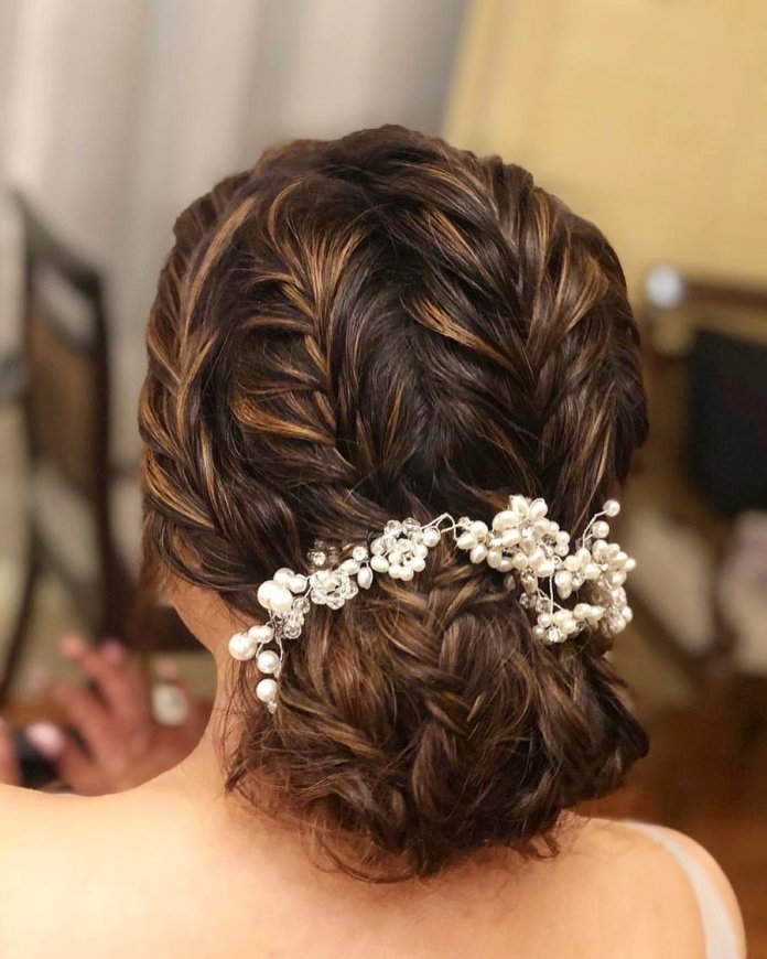Sleek-Crown-Braid-with-Cascading-Curls 21 Bridal Hairstyles 2020 for an Elegant Look