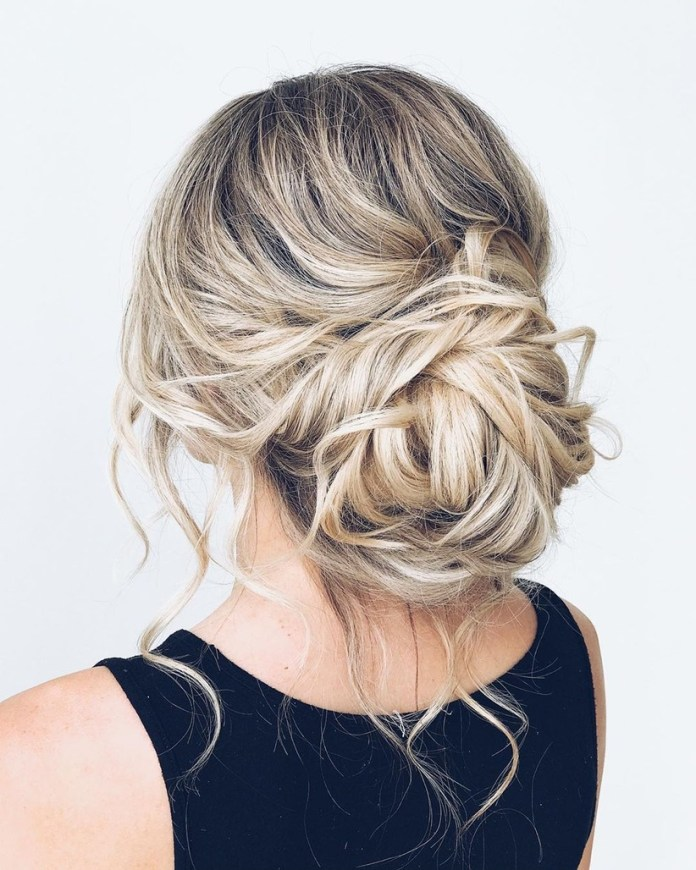 Snow-White-Spin-Textured-Messy-Bun Messy Bun Hairstyle is the New Style to Enhance Your Look