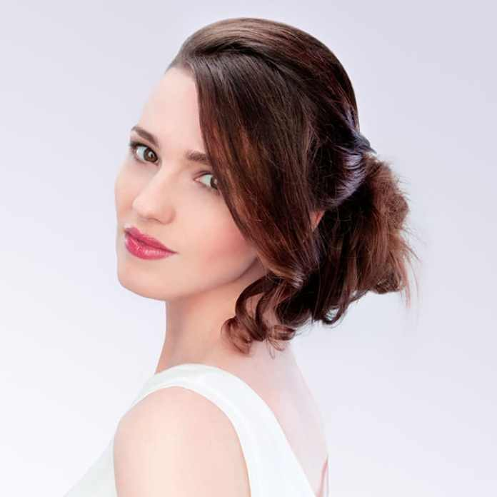 Sophisticated-Messy-Bun-with-Curled-Up-Tresses Messy Bun Hairstyle is the New Style to Enhance Your Look