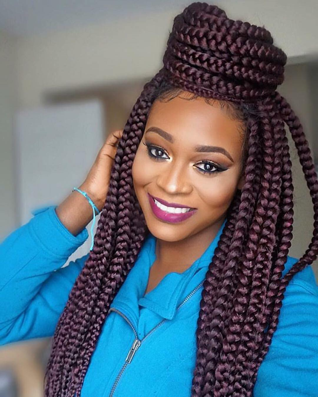 Top-Bun-with-Numerous-Braids 25 Black Braided Hairstyles for Voguish Look