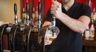 Barkeeper pulling a pint of beer