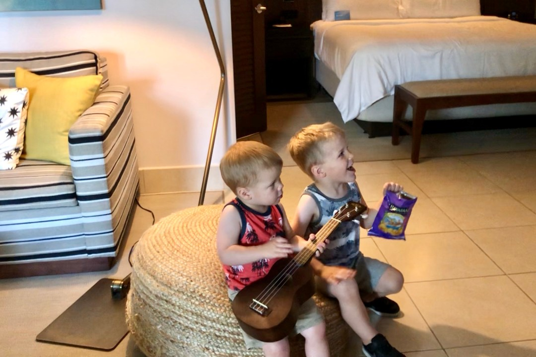 Kids enjoying the ukulele provided in the Junior Suite at the Wailea Beach Resort by Marriott