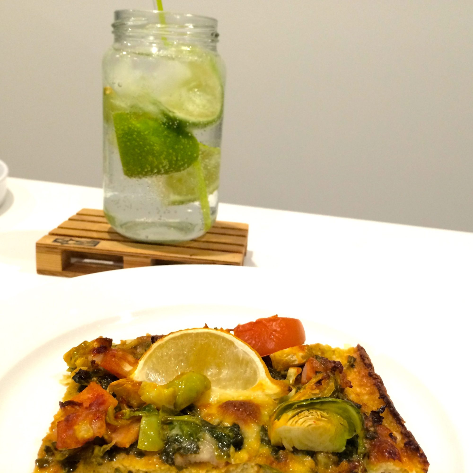 cauliflower pizza with brussel sprouts and pizza