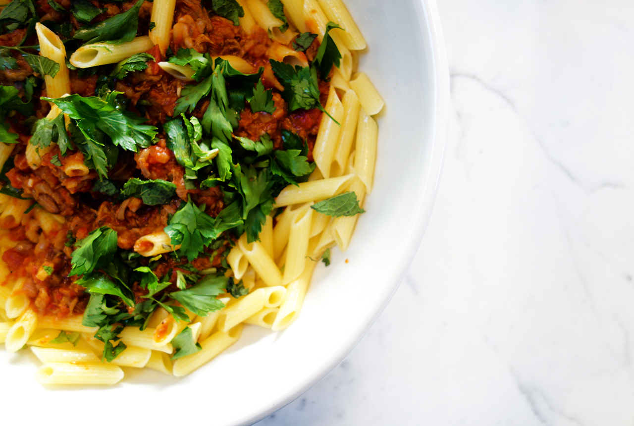 slow pulled lamb ragu on gluten free pasta